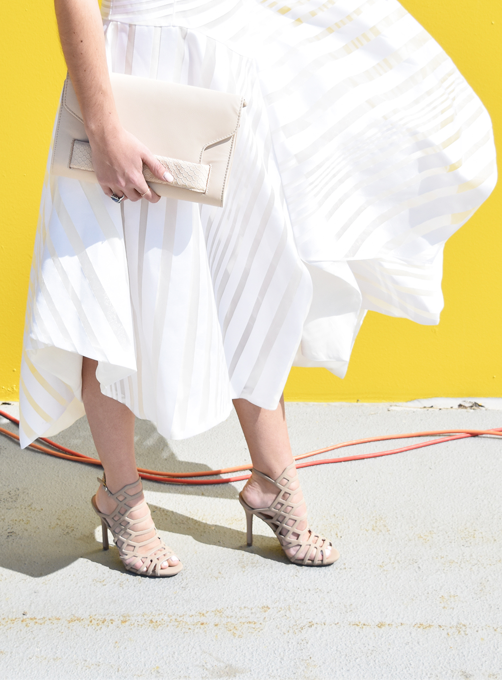 Keeping it monochrome. White Dress + Blush Bag + Nude Heels = Simple Elegance | www.wovenwithgold.com