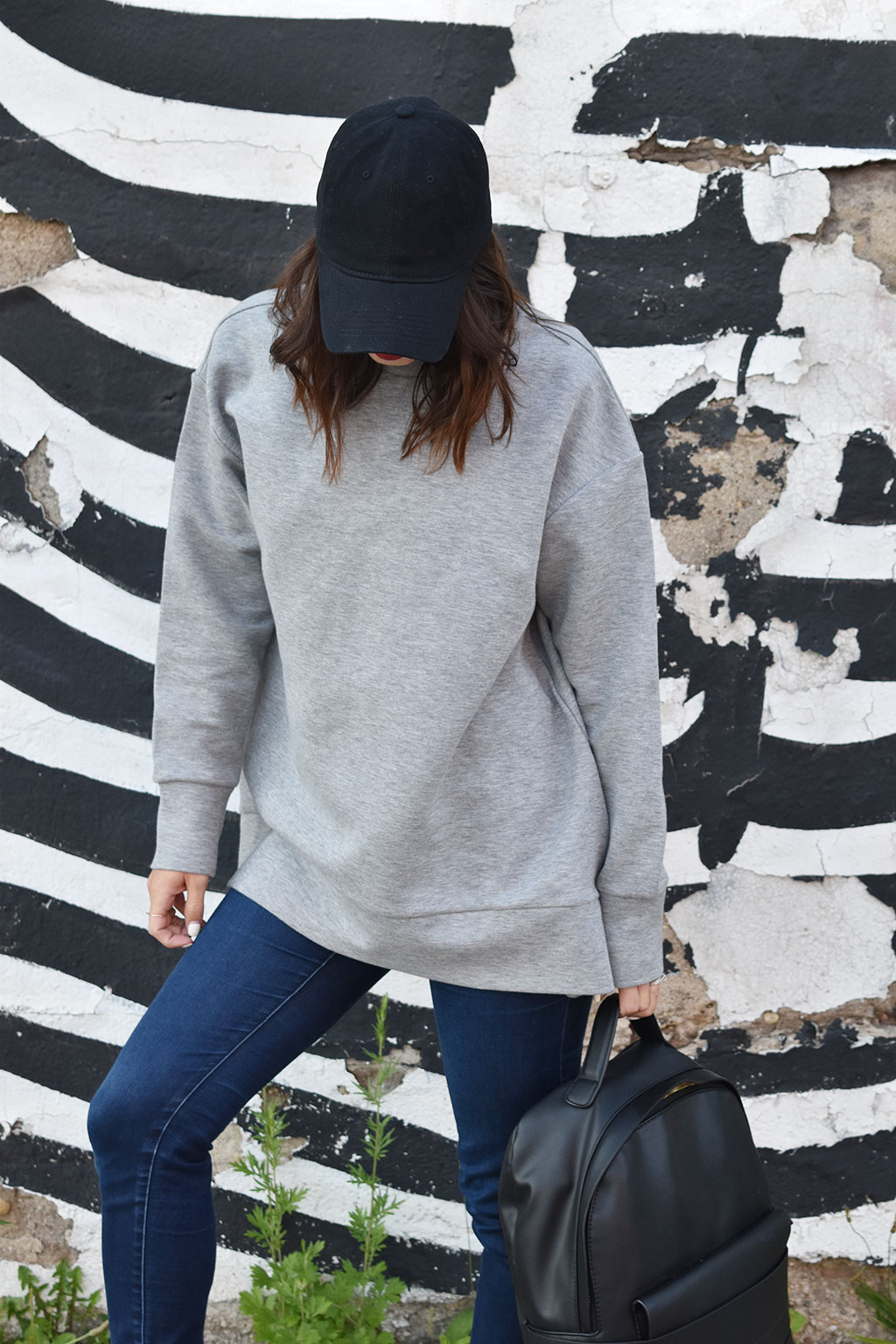 Oversized Proportions | Cos Gray Oversized Sweatshirt, Michael Michael Kors Skinny Jeans, Target Black Hat, Zara Black Leather Backpack, Nike Air Force Shoes