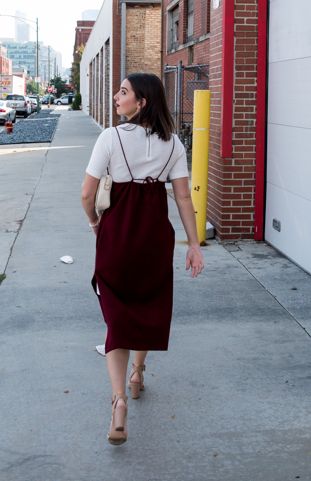 Creative Layering Fashion for Fall | Martel Burgundy Velvet Slip Dress, H&M White Ribbed Dress, KC Jagger Nude Cross Body Bag, Lori's Shoes Armitage Avenue Furry Key Chain, and Zara Nude & White Block Chunky Heeled Sandals