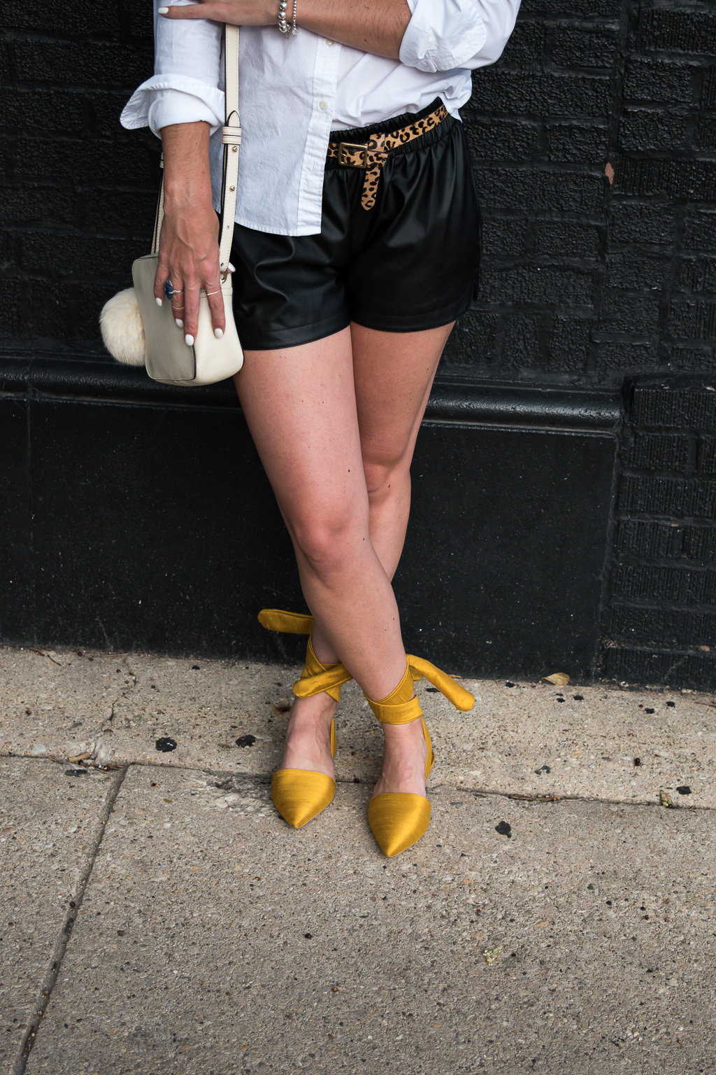 Transitioning to Fall with Faux Leather Shorts | J.Crew White Button Down Blouse, SheIn Faux Leather Shorts, Target Leapard Print Calf Hair Belt, Topshop Mustard Pointed Toe Lace Up Flats